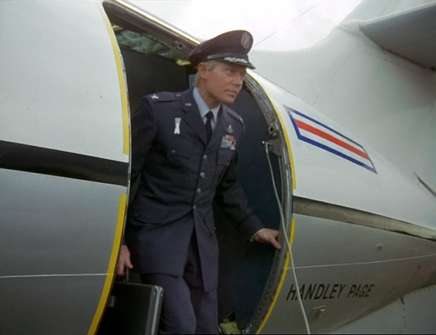 03.35 Straker appears in doorway of aircraft